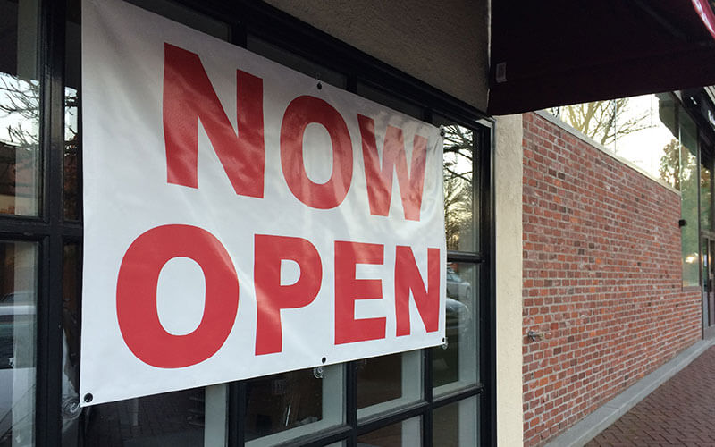 A Now Open Outdoor Banner