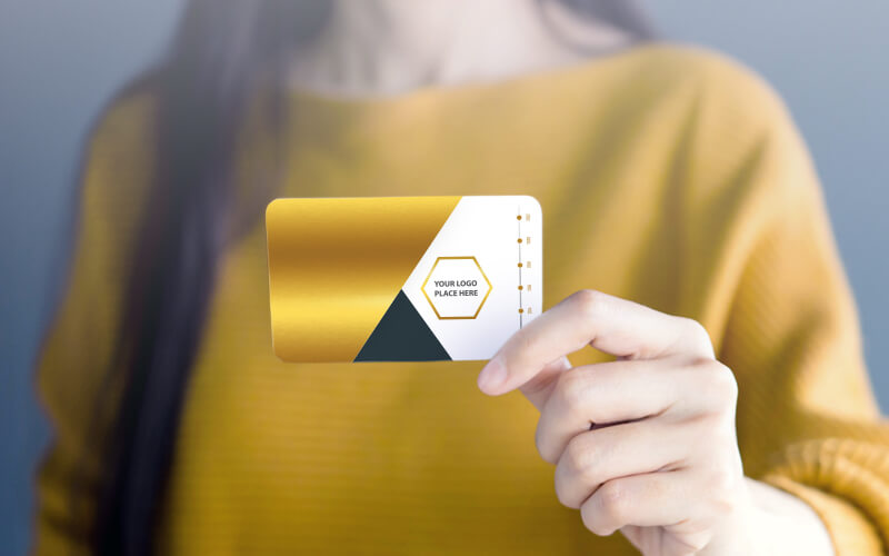 A Woman Holding A Gold Foil Business Card