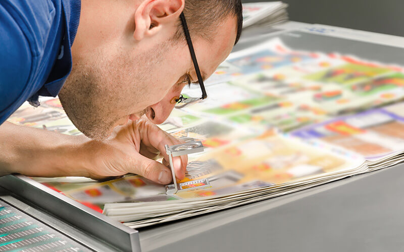 A Man Inspecting Printing